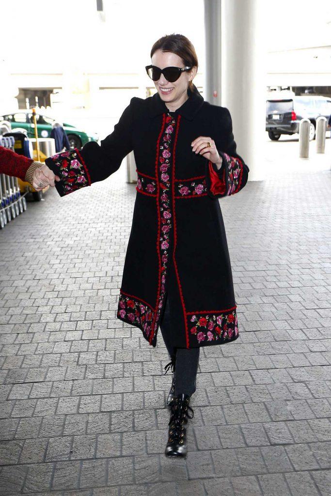 Emma Roberts in a Black Floral Print Coat