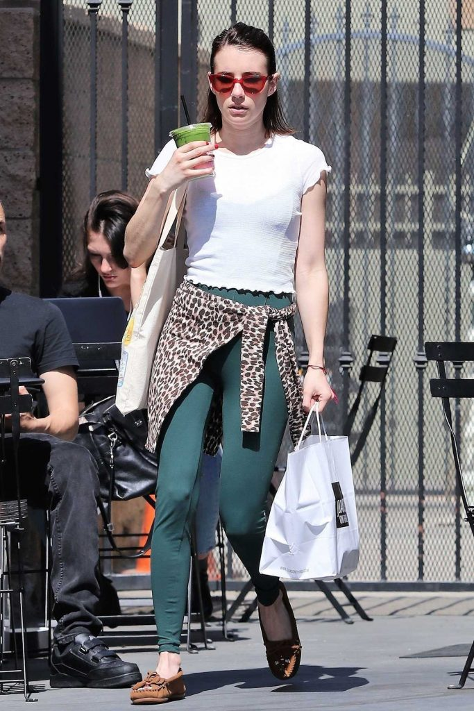 Emma Roberts in a Green Leggings
