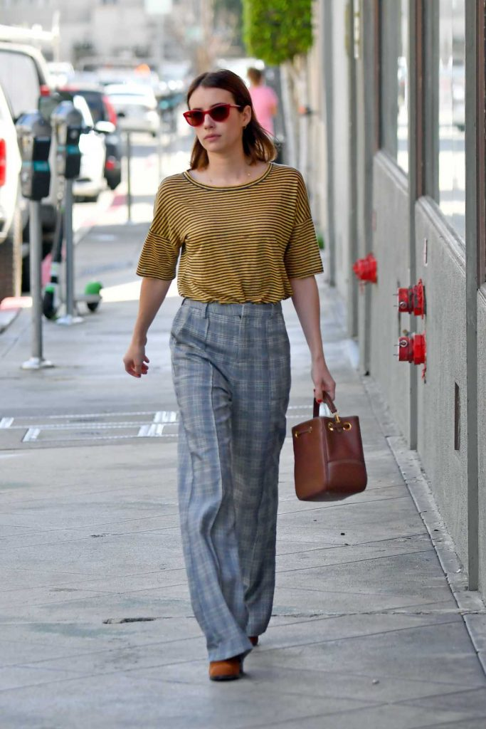 Emma Roberts in a Yellow Striped T-Shirt