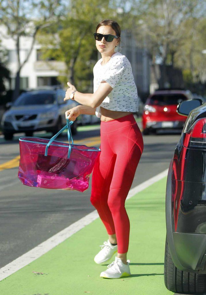 Irina Shayk in a Red Leggings