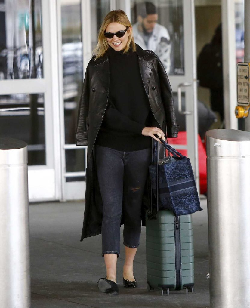 Karlie Kloss in a Black Leather Trench Coat