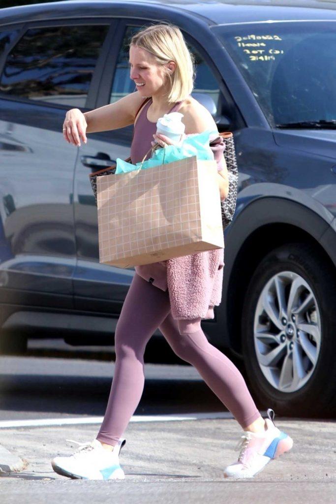 Kristen Bell in a Purple Leggings