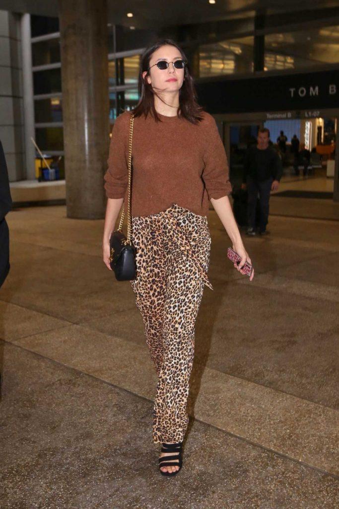 Nina Dobrev in a Leopard Print Pants