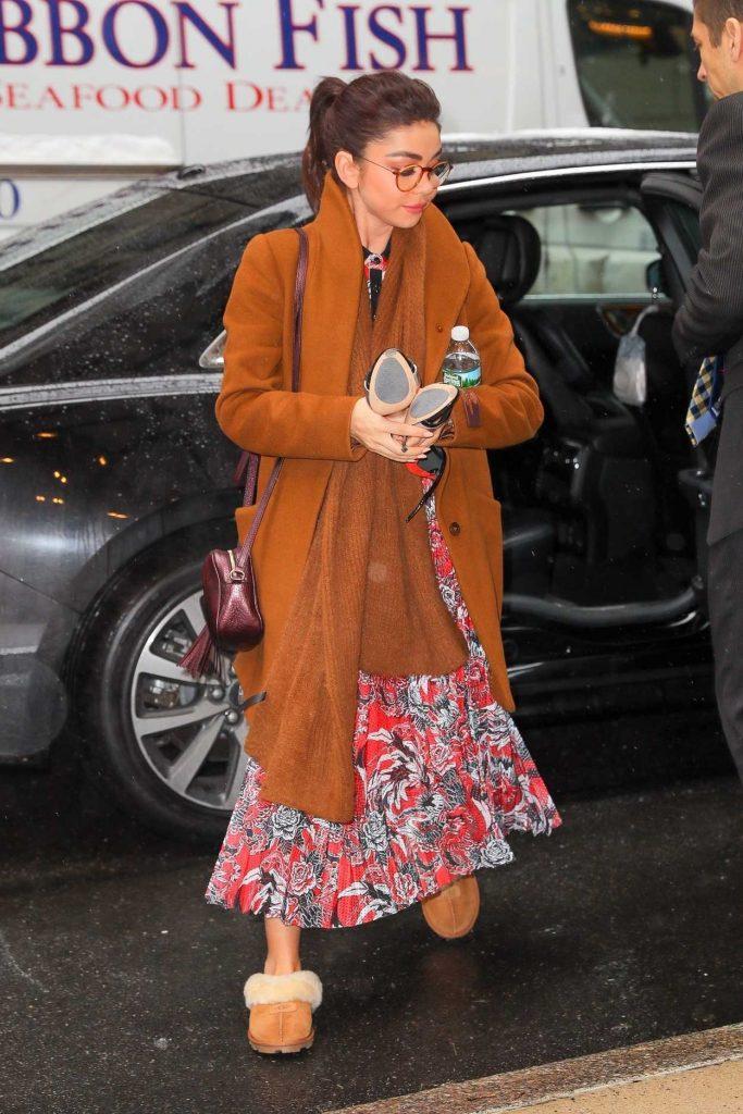 Sarah Hyland in an Orange Coat
