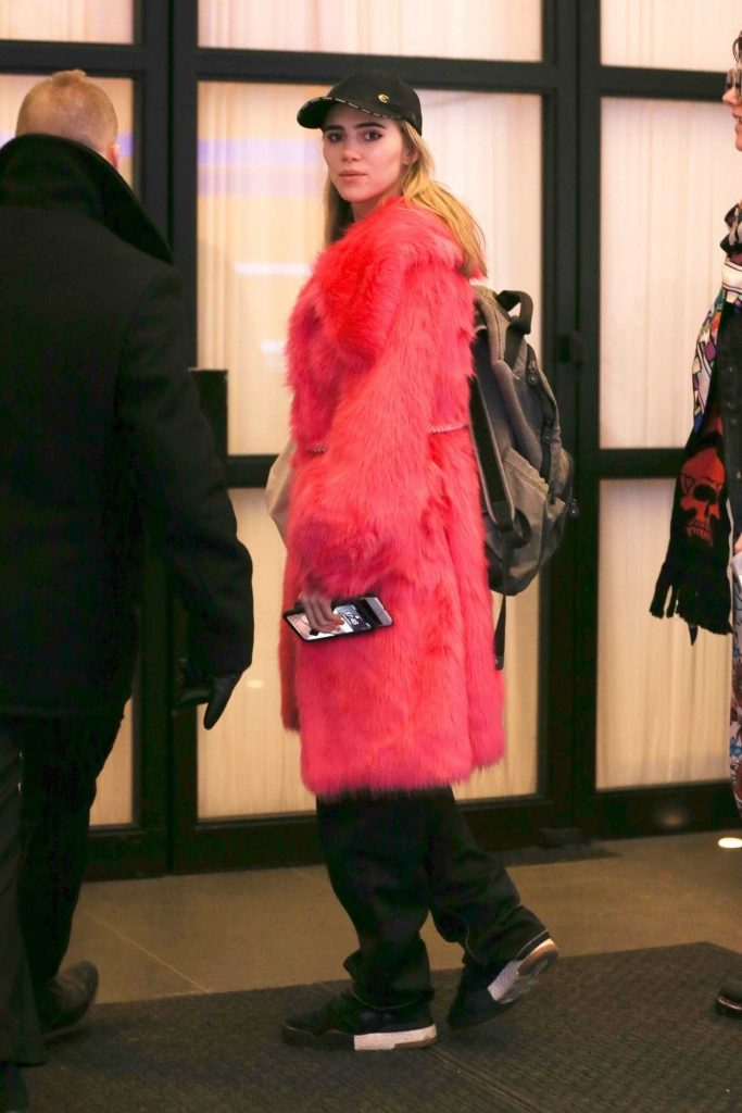 Suki Waterhouse in a Pink Fur Coat