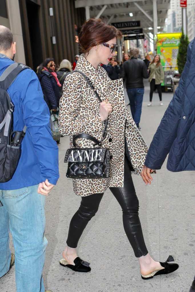 Anne Hathaway in a Leopard Print Trench Coat