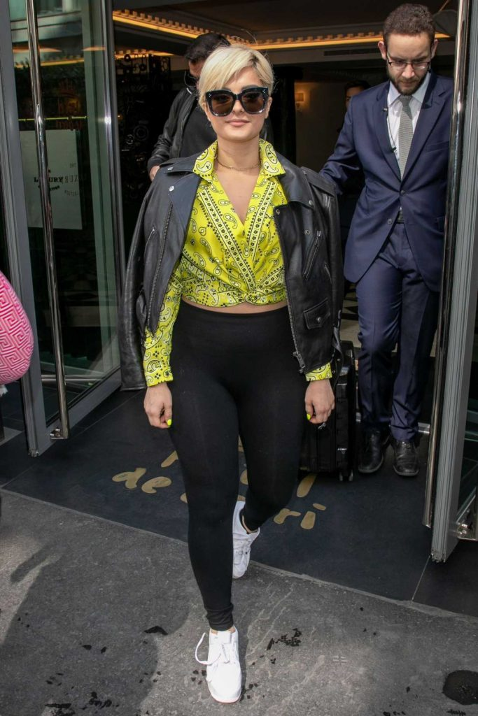 Bebe Rexha in a Yellow Blouse