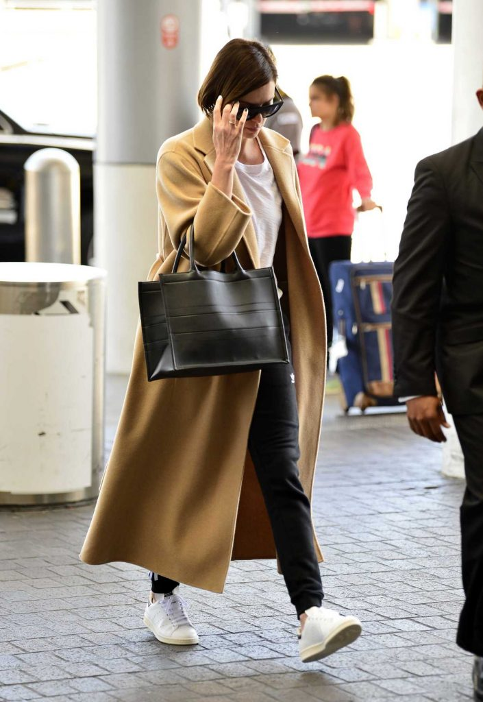 Charlize Theron in a Beige Coat
