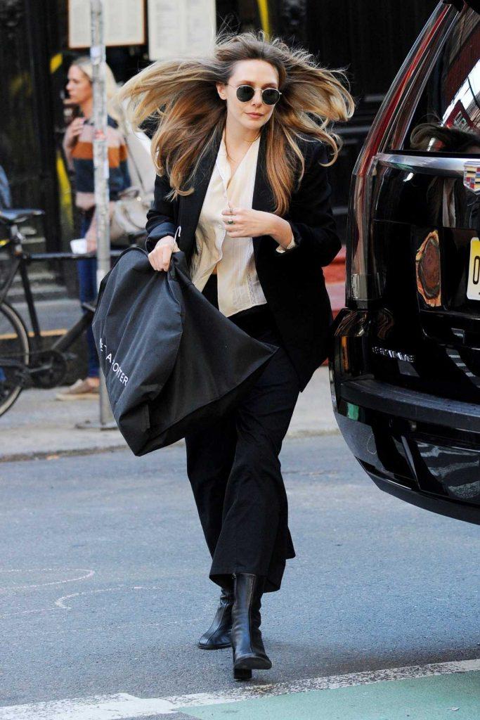 Elizabeth Olsen in a Black Suit