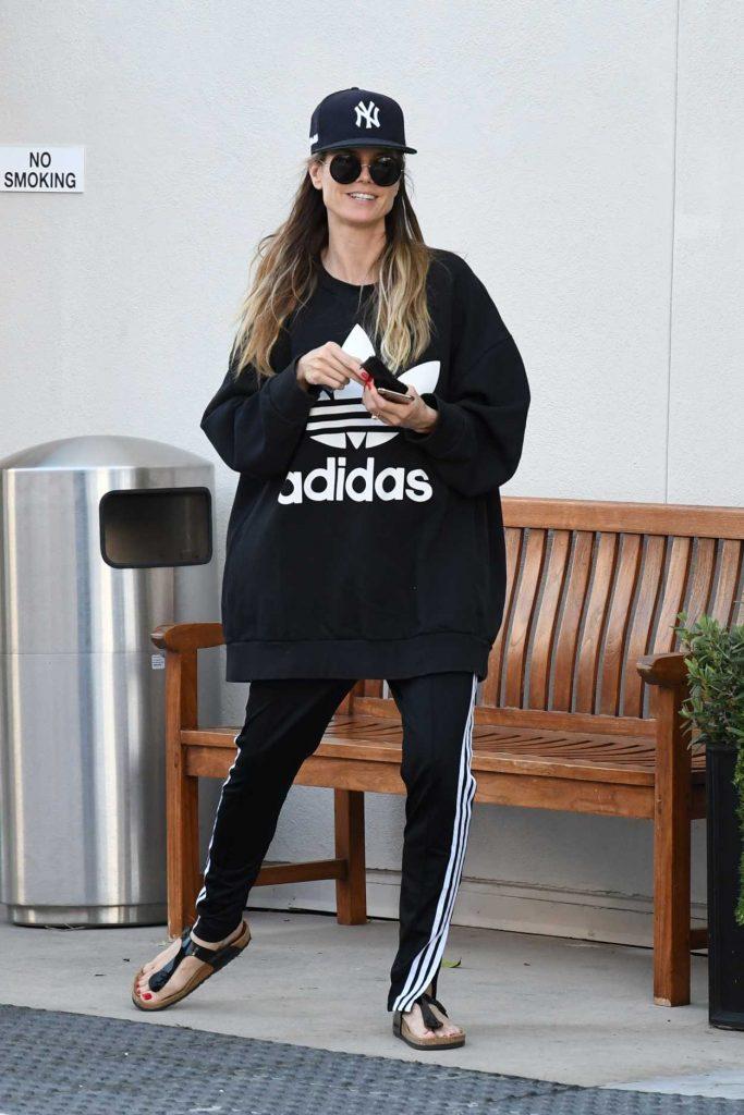 Heidi Klum in a Black Adidas Sweatshirt