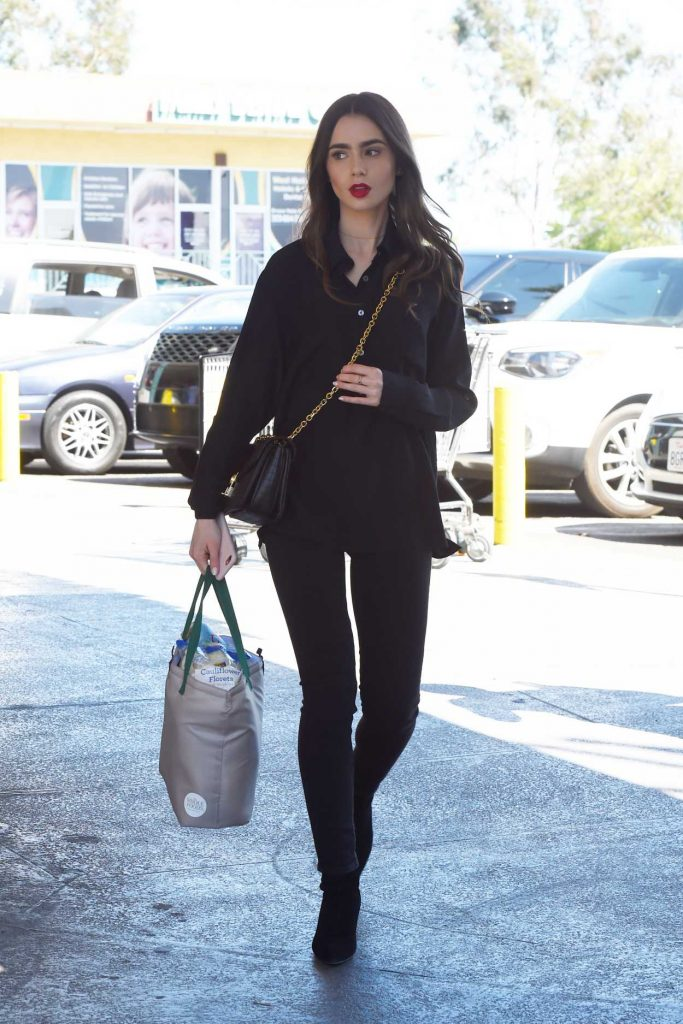 Lily Collins in a Black Shirt