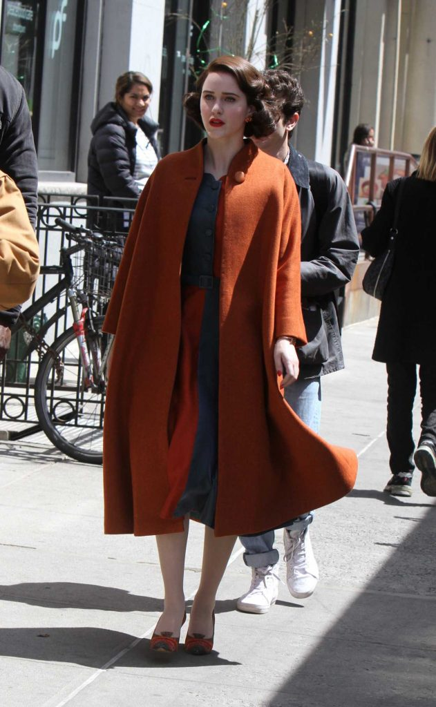 Rachel Brosnahan in an Orange Coat