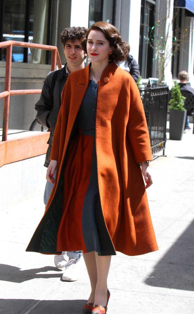 Rachel Brosnahan in an Orange Coat