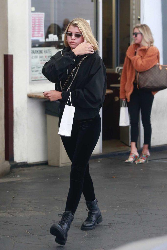 Sofia Richie in a Black Boots