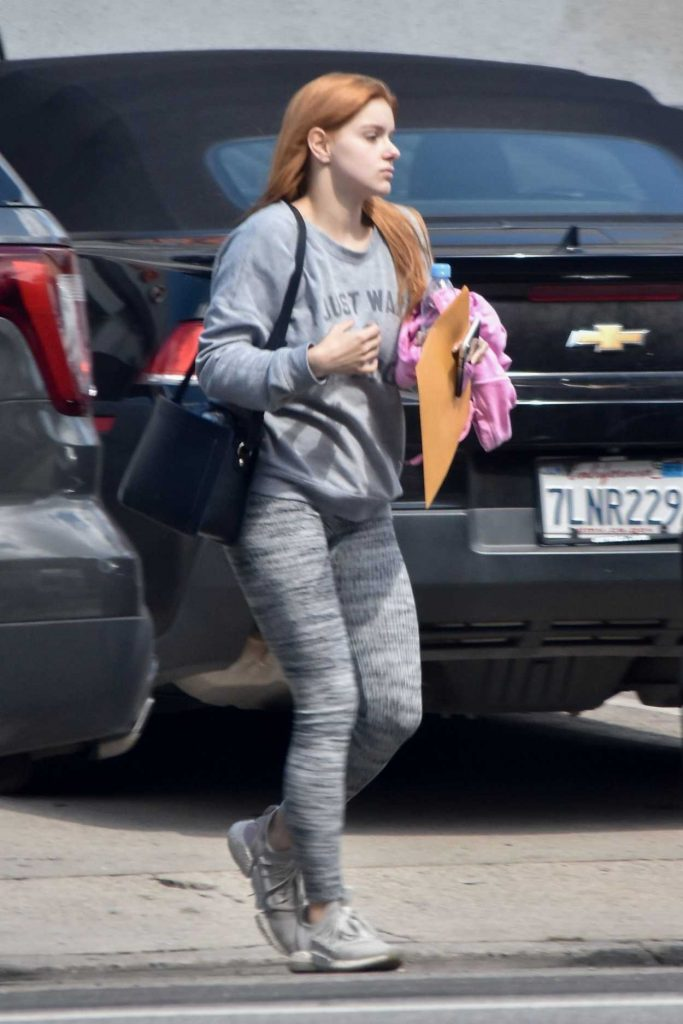 Ariel Winter in a Gray Sweatshirt