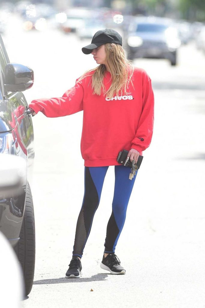 Ashley Benson in a Red Sweatshirt