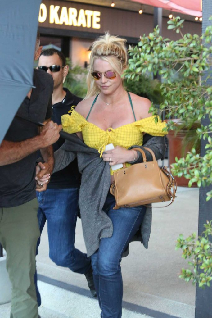 Britney Spears in a Yellow Blouse