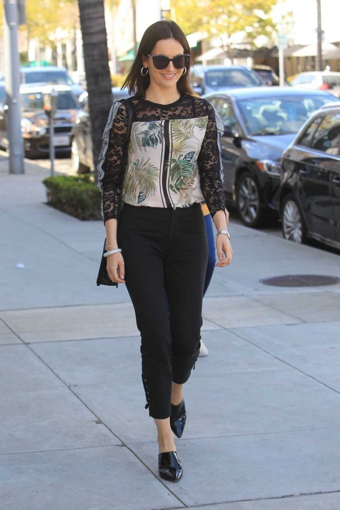 Camilla Belle in a Black Pants