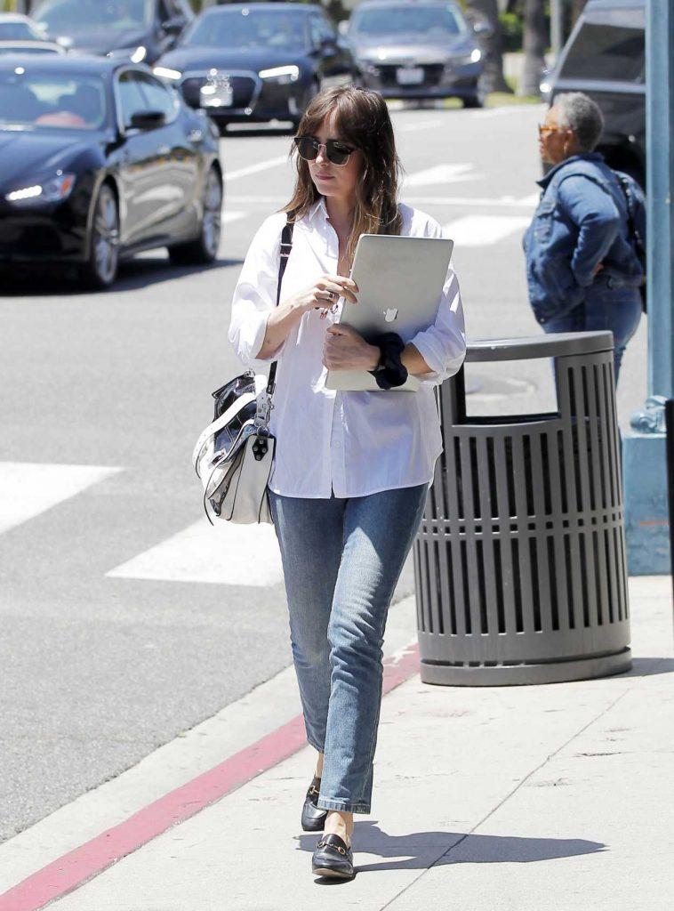 Dakota Johnson in a White Blouse