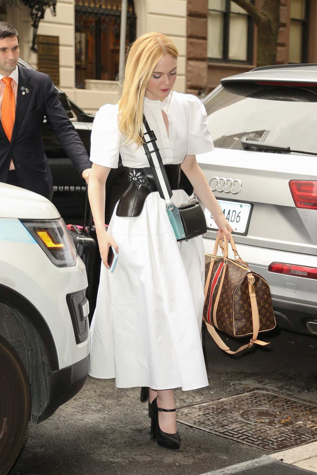 Elle Fanning In A White Dress Was Seen Out In Nyc 05 01