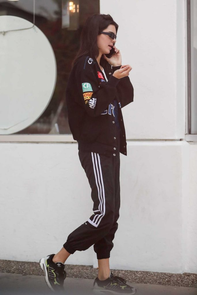 Kendall Jenner in a Black Adidas Track Pants
