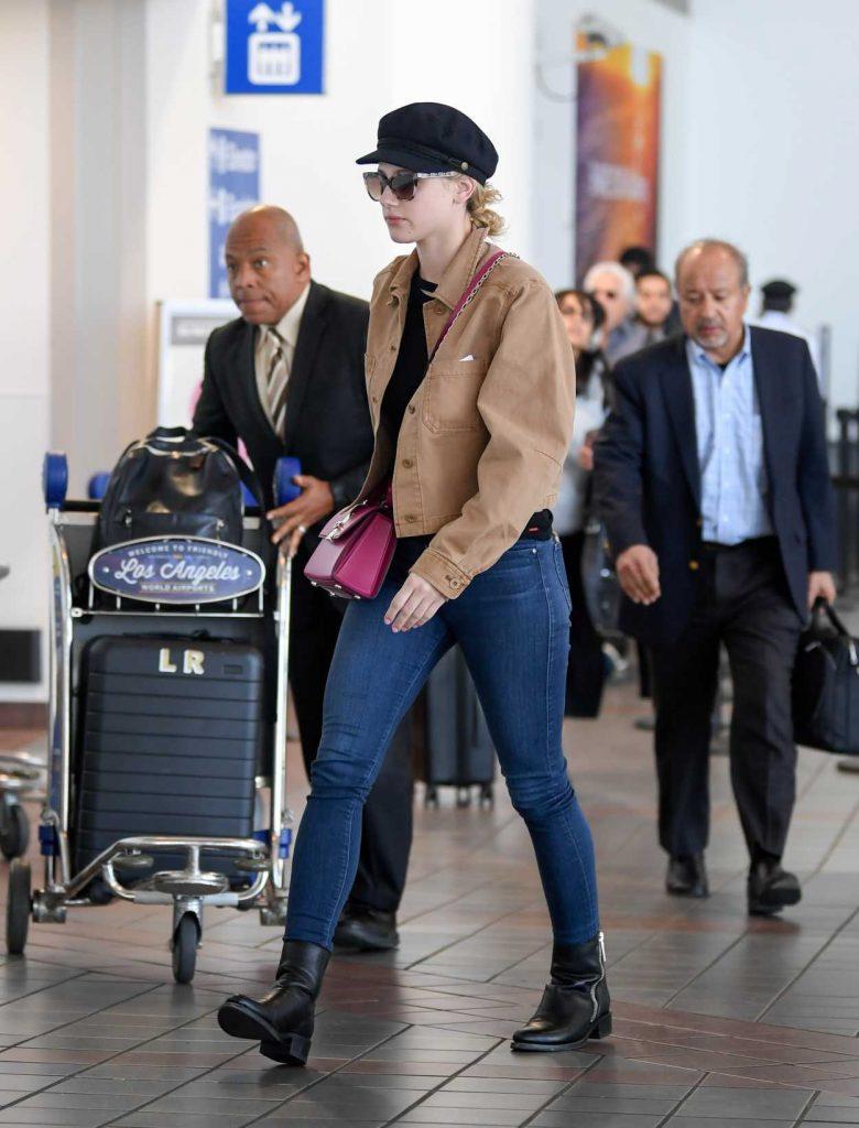 Lili Reinhart in a Beige Jacket