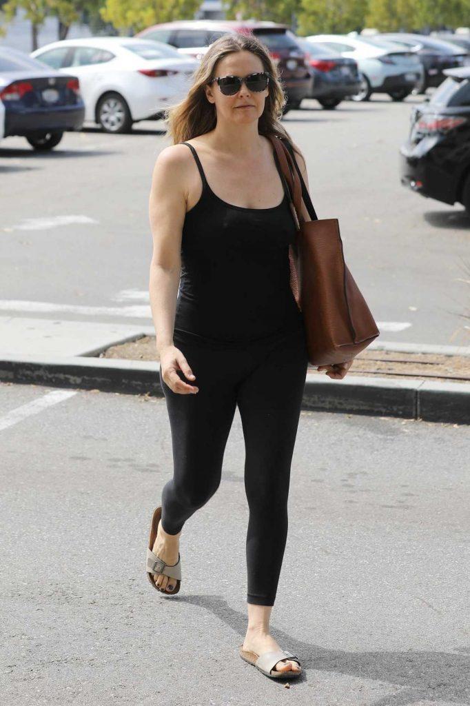 Alicia Silverstone in a Black Leggings