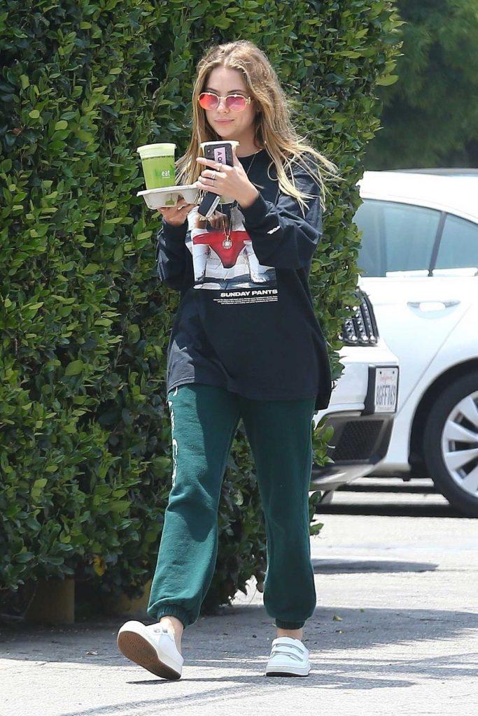 Ashley Benson in a Green Sweatpants