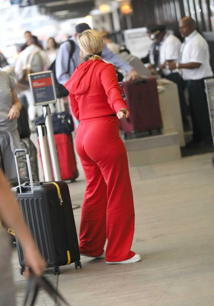 Bebe Rexha in a Red Tracksuit