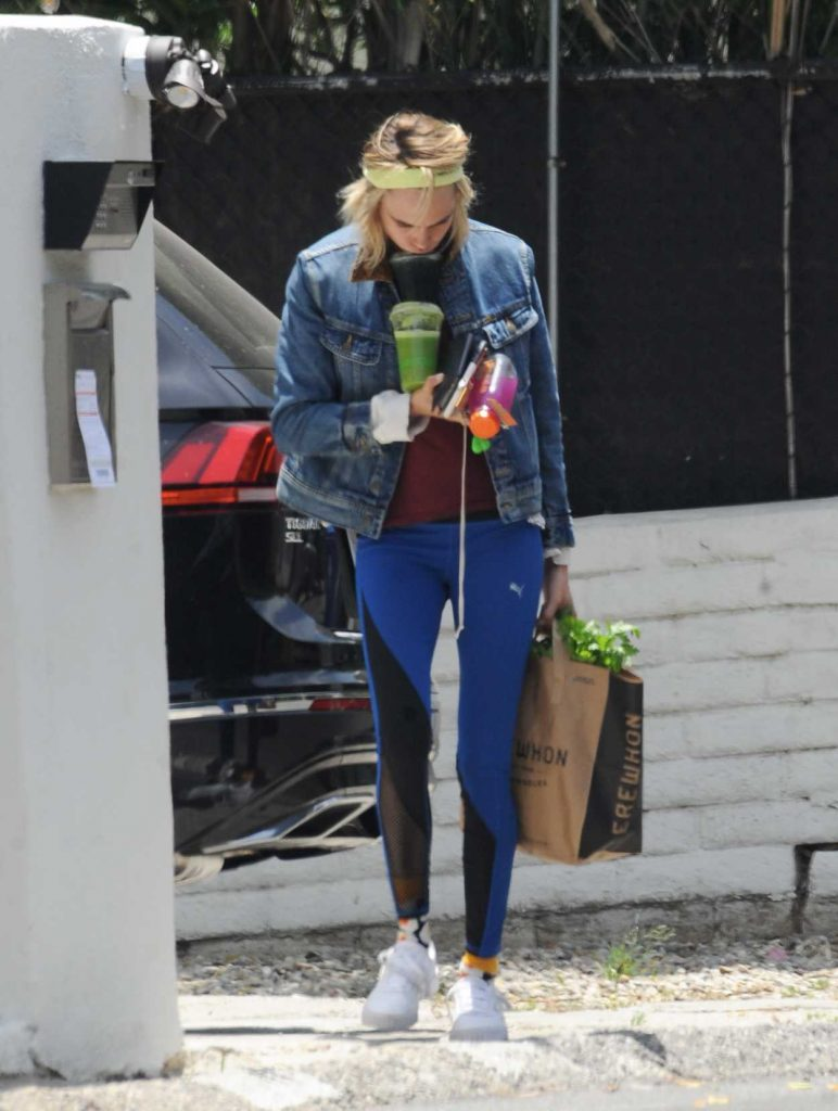Cara Delevingne in a Blue Denim Jacket