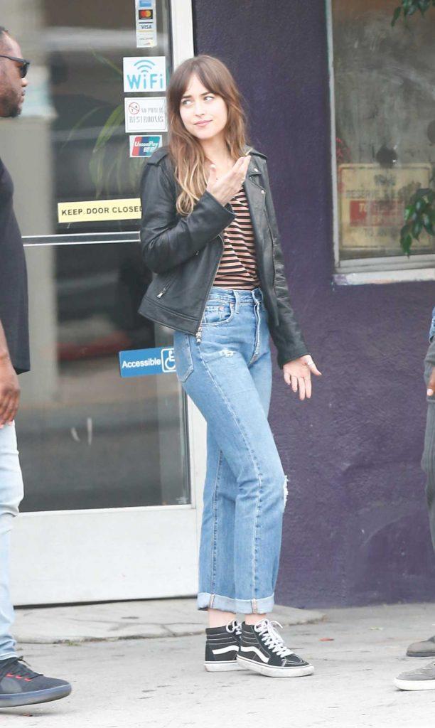 Dakota Johnson in a Blue Ripped Jeans
