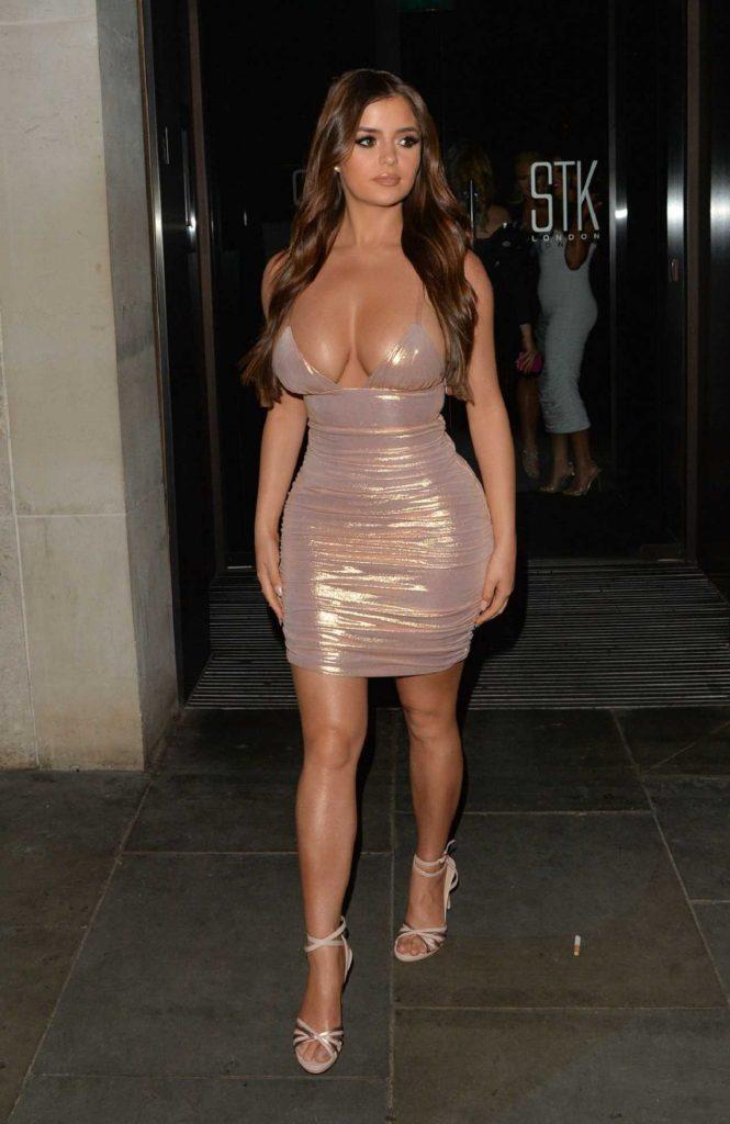 Demi Rose in a Beige Form Fitting Dress