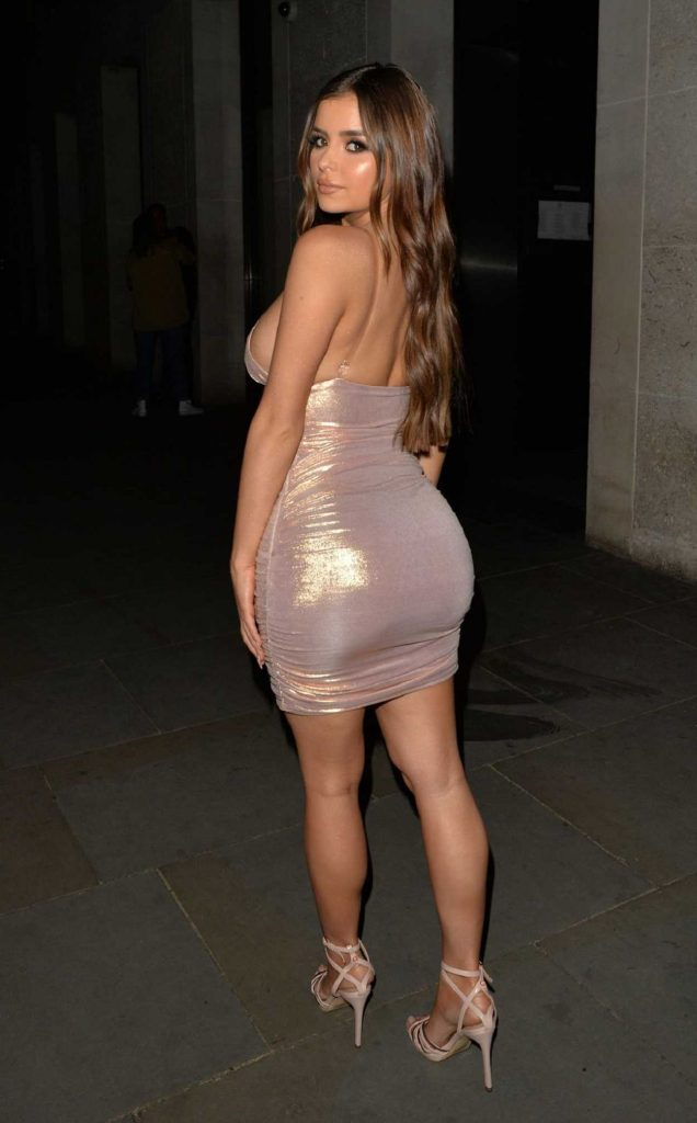 Demi Rose in a Beige Form Fitting Dress