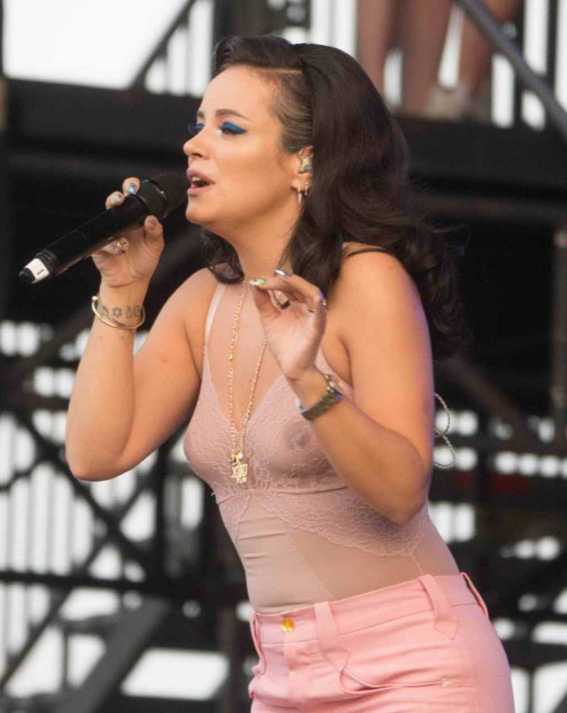 Lily Allen in a Pink Transparent Blouse