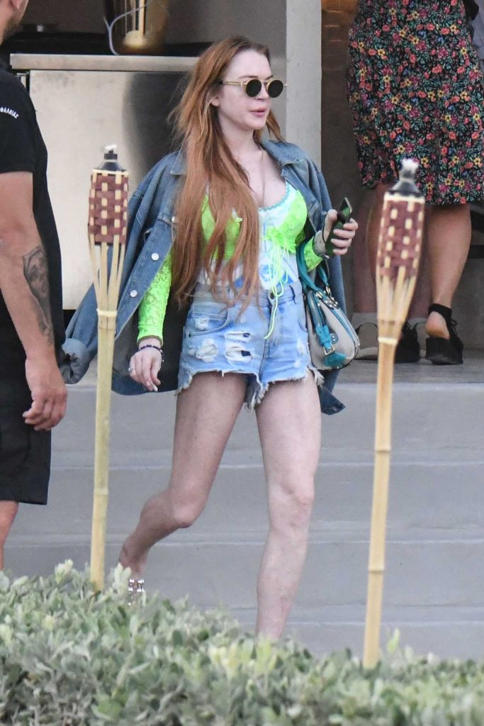 Lindsay Lohan in a Denim Ripped Shorts