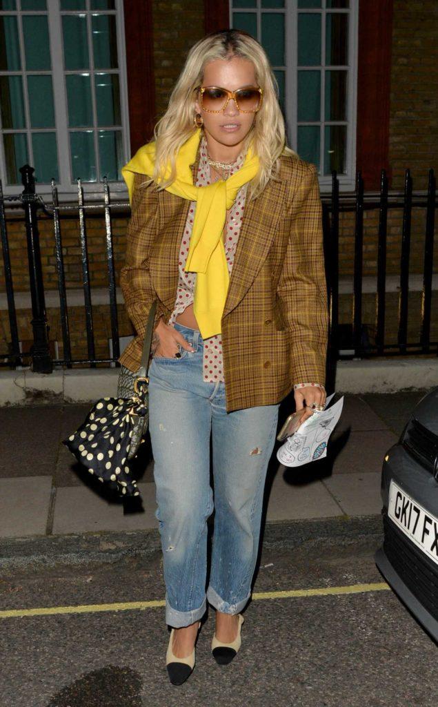 Rita Ora in a Blue Ripped Jeans