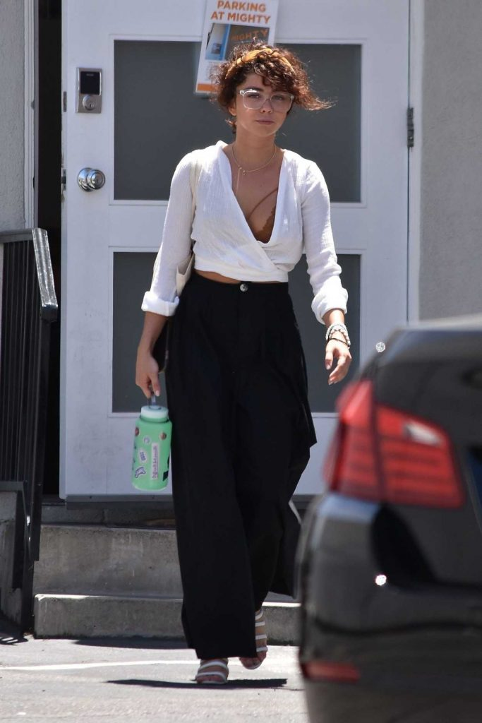 Sarah Hyland in a White Blouse