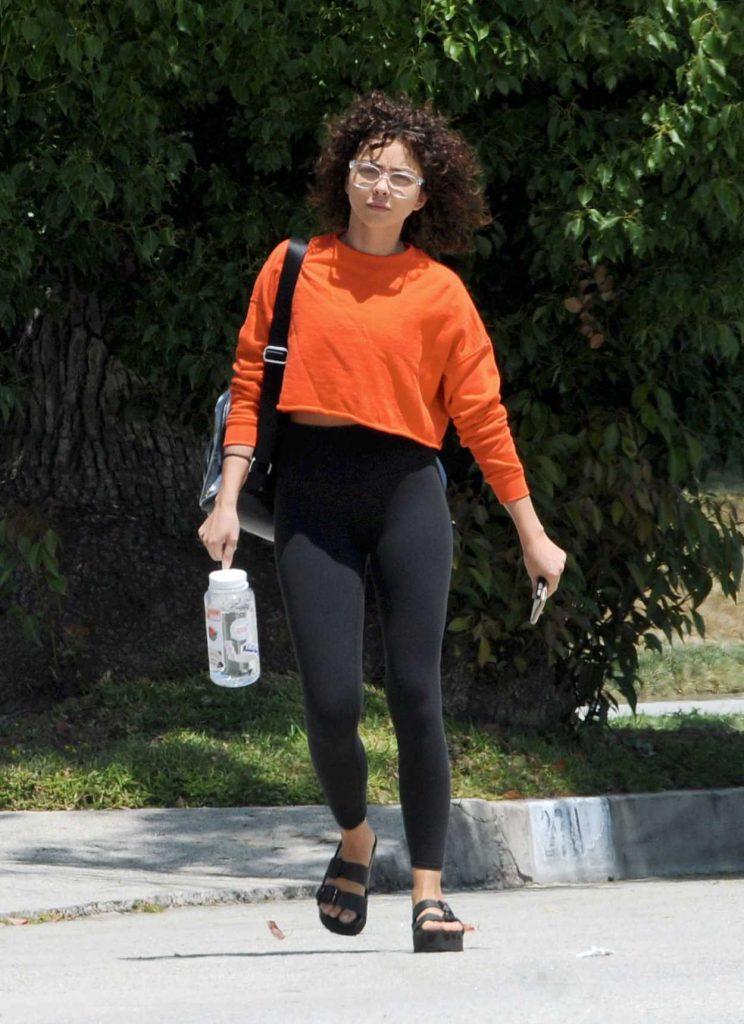 Sarah Hyland in an Orange Cropped Sweatshirt