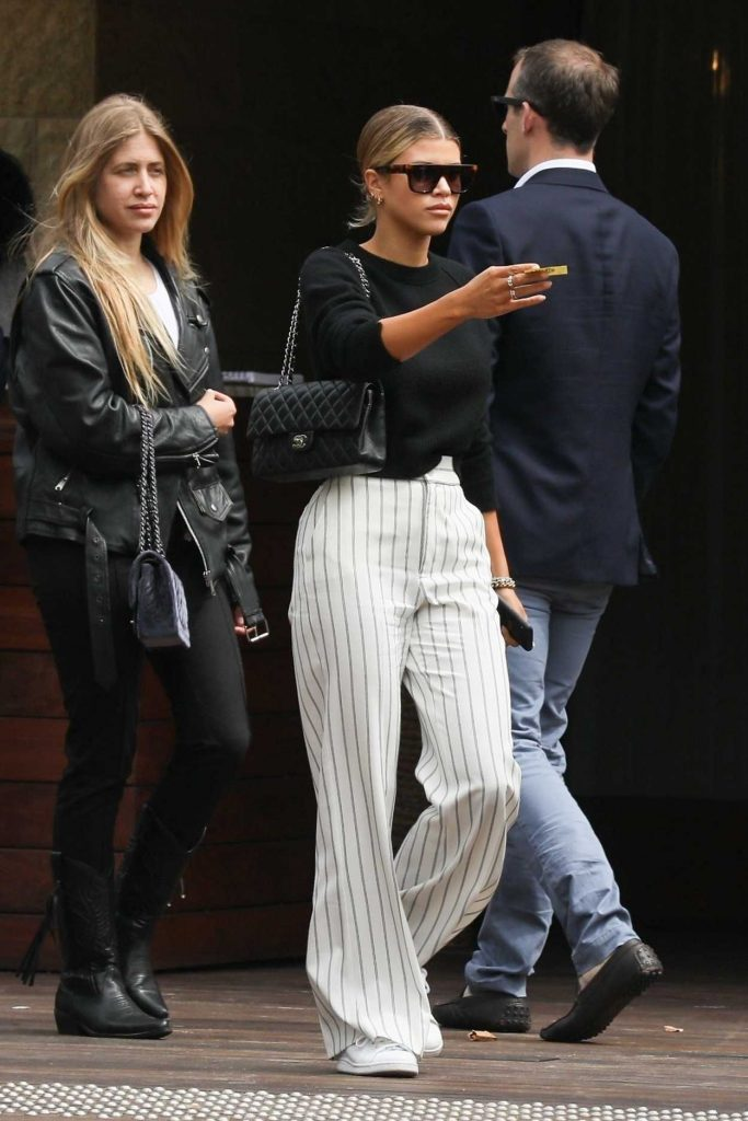 Sofia Richie in a White Striped Pants