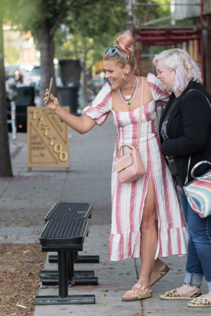 Busy Philipps in a White and Pink Striped Dress