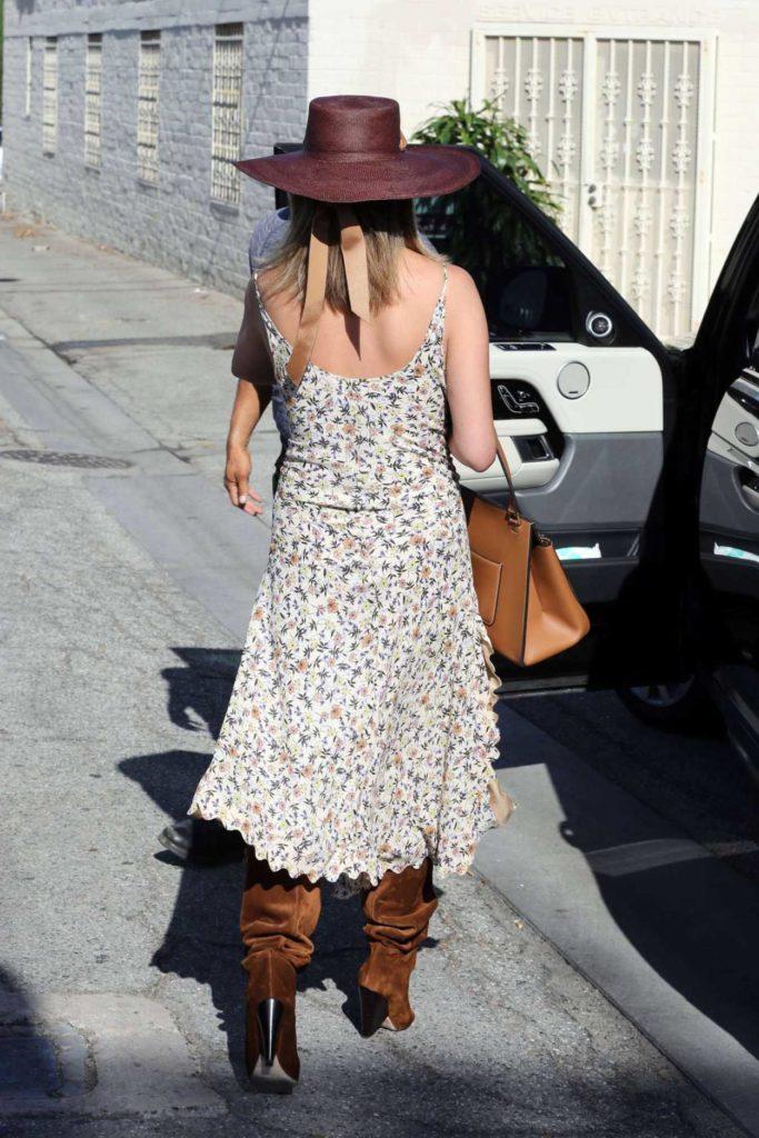 Chrissy Teigen in a Floral Sundress
