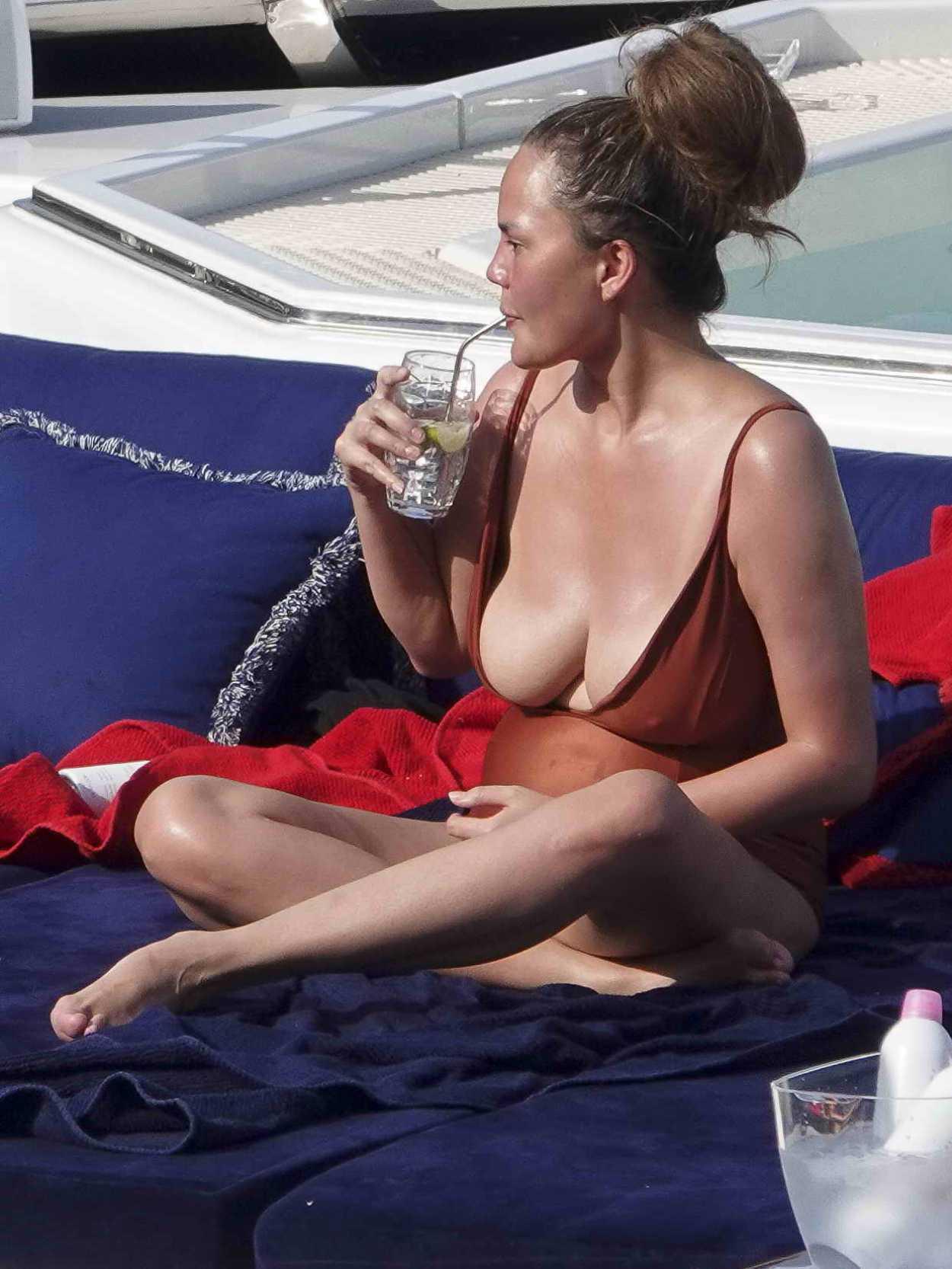 Chrissy Teigen In A Red Swimsuit On A Yacht In Portofino