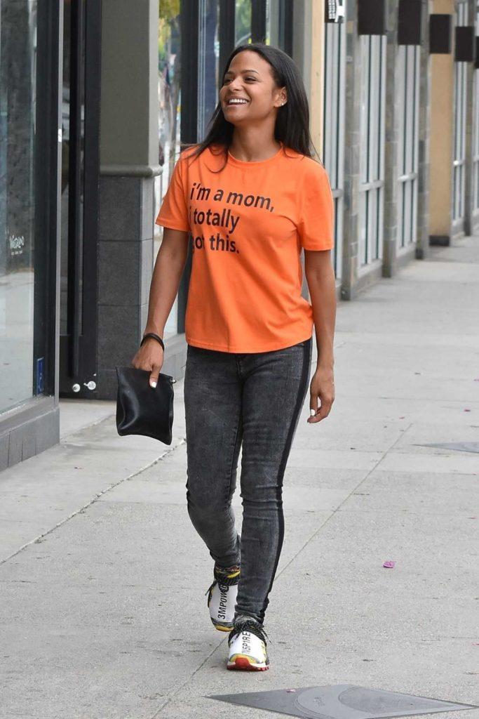 Christina Milian in an Orange Tee