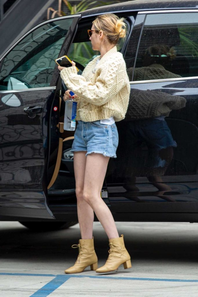 Emma Roberts in a Blue Daisy Duke Shorts