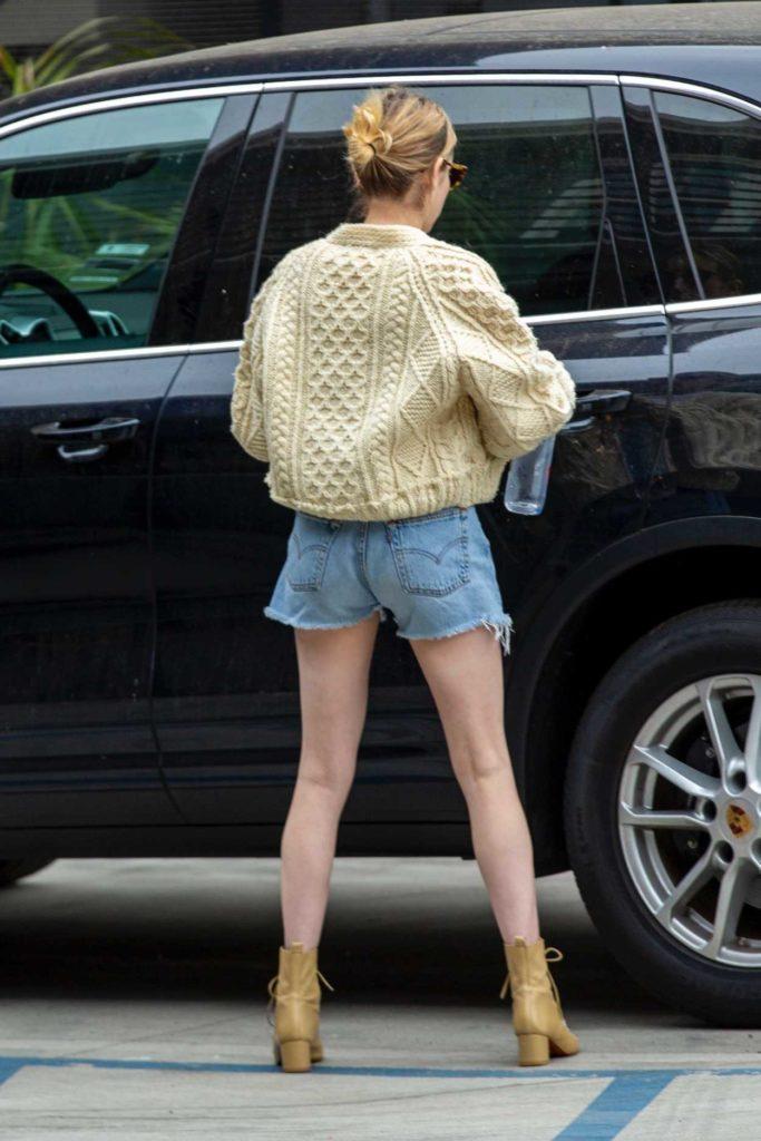 Emma Roberts in a Blue Daisy Duke Shorts
