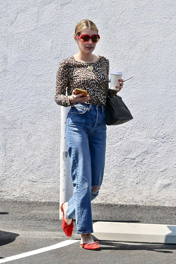 Emma Roberts in a Leopard Print Blouse
