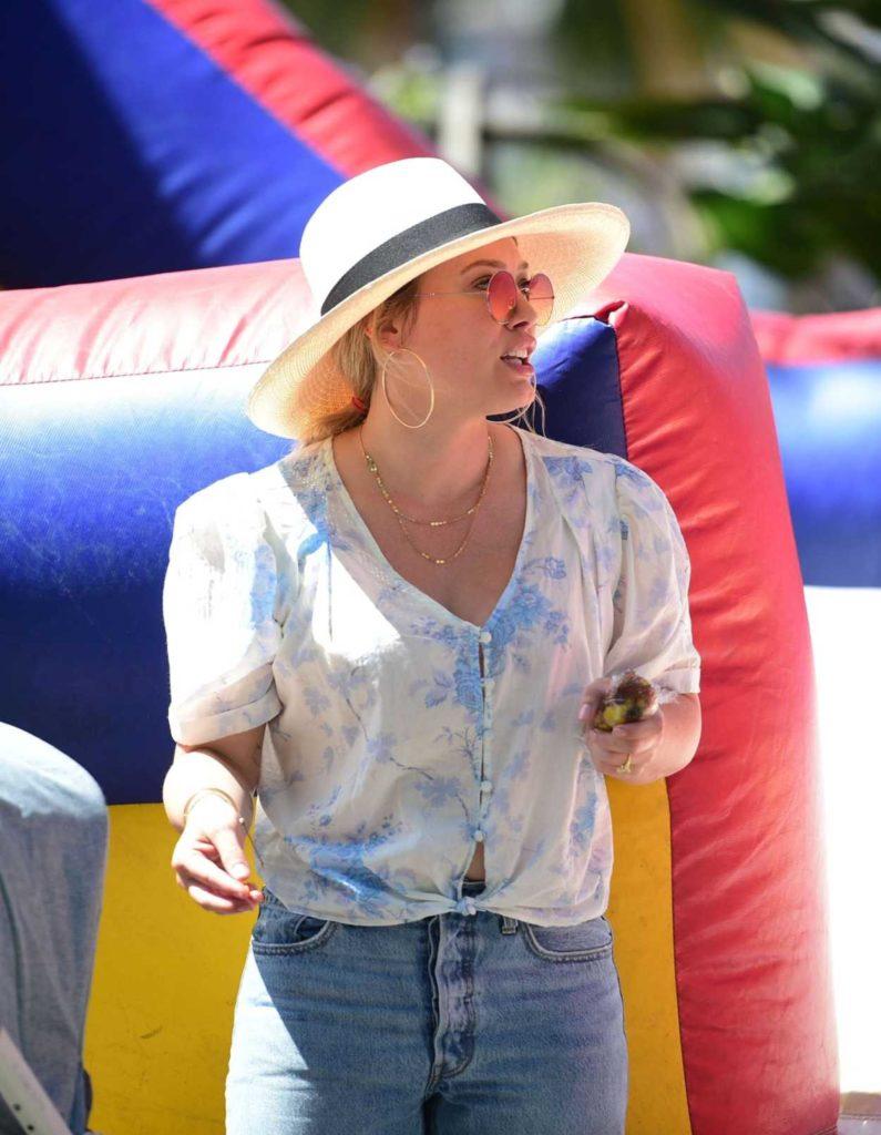 Hilary Duff in a Beige Hat