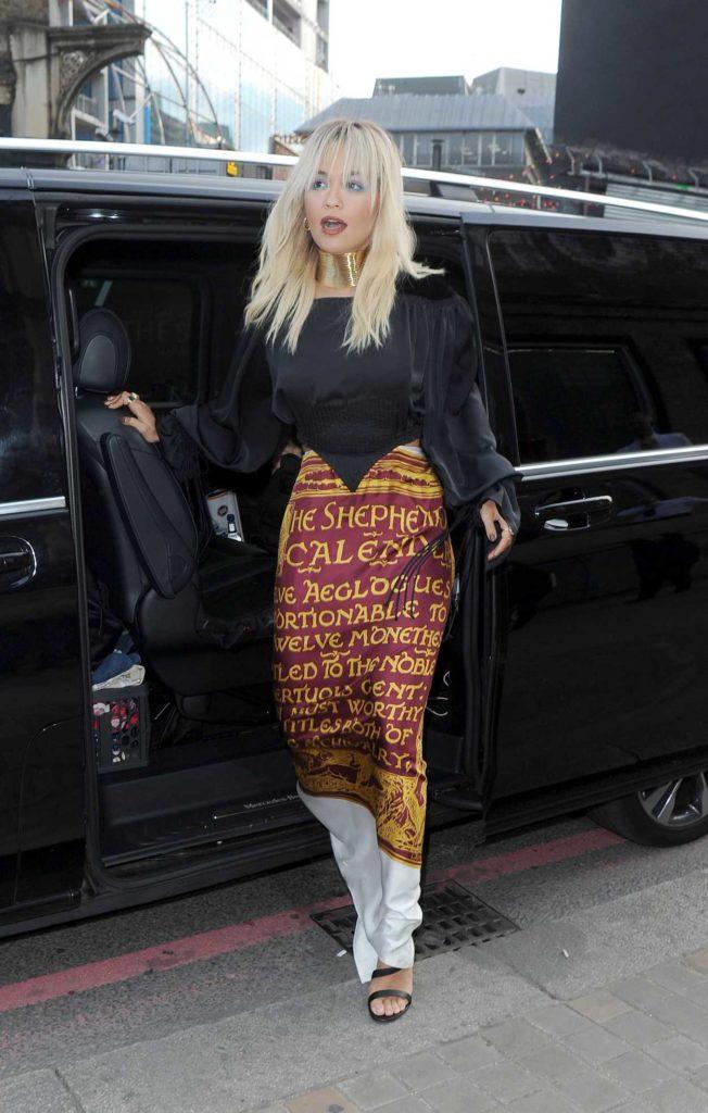 Rita Ora in a Blak Blouse