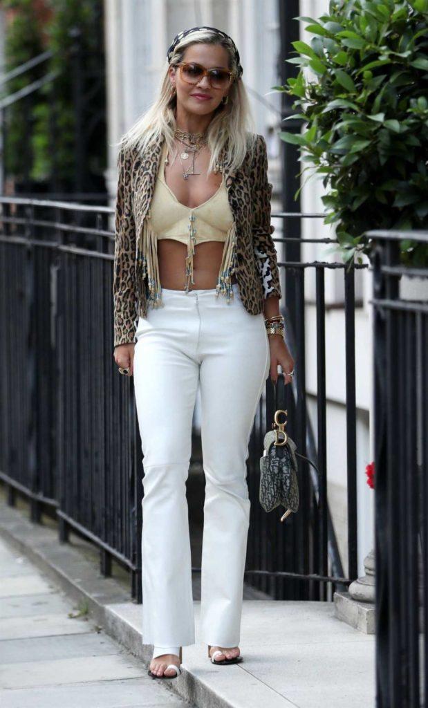 Rita Ora in a Yellow Bikini Top