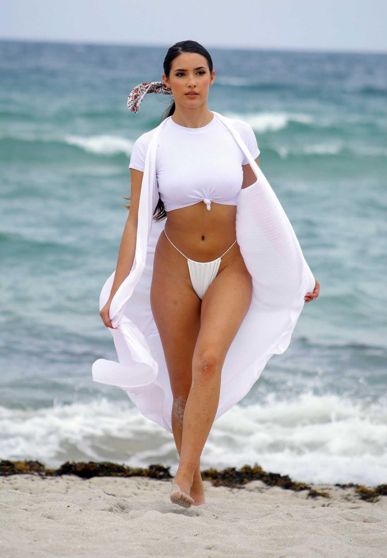 Tao Wickrath in a White Bikini on the Beach in Miami 07/24/2019 - celebsla.com